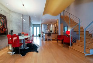 Contemporary Staircase with Laminate floors, curved staircase, High ceiling