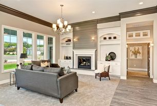 Traditional Living Room with Wall sconce, Transom window, French doors, Crown molding, Chandelier, Built-in bookshelf
