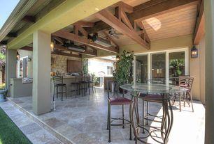 Rustic Porch with Bird bath, sliding glass door, exterior stone floors, picture window, Outdoor kitchen