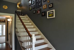Traditional Staircase with Paint 1, Casement, Standard height, Hardwood floors, Wall sconce