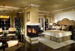 Traditional Master Bedroom with double-hung window, Paint 1, Crown molding, Chandelier, picture window, Fireplace, can lights