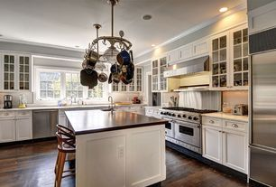 Contemporary Kitchen with can lights, Complex marble counters, Kitchen island, Hardwood floors, partial backsplash, Paint 1
