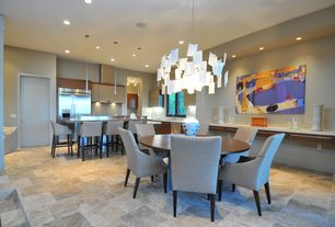 Contemporary Dining Room with Paint 1, stone tile floors, Casement, Machu picchu, can lights, Built-in bookshelf, flat door