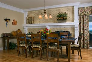 Traditional Dining Room with Standard height, Fireplace, brick fireplace, picture window, Chandelier, Crown molding