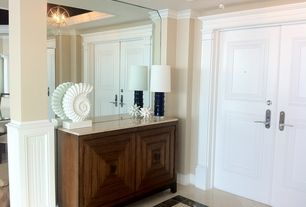Traditional Entryway with Standard height, complex marble floors, French doors, Chandelier, Crown molding