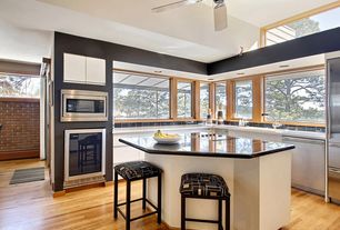Modern Kitchen with Breakfast bar, can lights, Soapstone counters, Flush, High ceiling, Multiple Refrigerators, drop-in sink