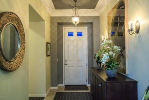 Eclectic Entryway with Crown molding, sandstone floors, Standard height, Glass panel door, Wall sconce, Pendant light