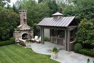 Traditional Patio with Outdoor fireplace, Pathway, Fence, Outdoor kitchen, exterior stone floors, Paint