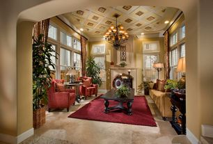 Mediterranean Living Room with stone tile floors, Chandelier, Imperial dragon design rosewood coffee table, picture window
