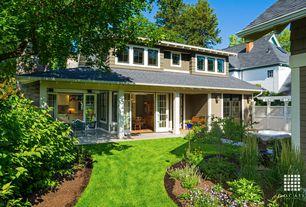 Traditional Landscape/Yard with exterior concrete tile floors, exterior tile floors, Fence, Casement, French doors, Paint