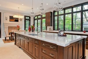 Traditional Kitchen with Flush, limestone tile floors, Kitchen island, Flat panel cabinets, Transom window, Raised panel