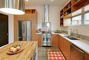 Modern Kitchen with Travertine Tile, European Cabinets, Rusty orange modern honeycomb rug, 2' x 3', Long tab pull, Stone Tile