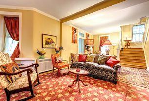 Cottage Living Room with Hardwood floors, Glass panel door, Built-in bookshelf, Crown molding