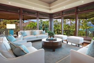 Contemporary Living Room with Landon upholstered sofa, Throw pillows, Palm trees, can lights, picture window, Table lamp