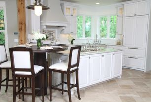 Traditional Kitchen with Breakfast nook, Kitchen island, slate tile floors, Custom hood, Raised panel, Flush, Undermount sink