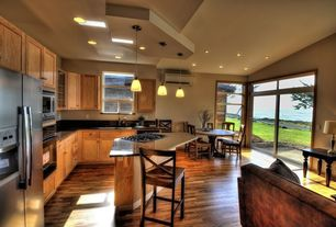 Craftsman Kitchen with can lights, built-in microwave, picture window, Soapstone counters, Flat panel cabinets, Flush