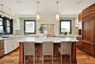 Traditional Kitchen with full backsplash, Built In Panel Ready Refrigerator, Crown molding, Ceramic Tile, Custom hood