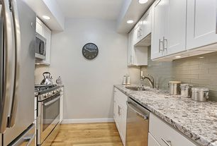 Modern Kitchen with Flush, gas range, dishwasher, Hardwood floors, can lights, Subway Tile, built-in microwave, Paint