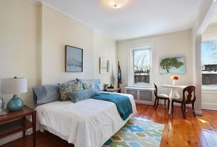 Traditional Guest Bedroom with Crown molding, Hardwood floors, flush light