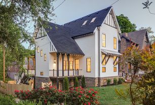Traditional Exterior of Home with French doors, Fence, exterior awning, Skylight