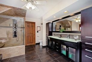 Craftsman Master Bathroom with Glass counters, partial backsplash, Glass panel, European Cabinets, stone tile floors, Shower
