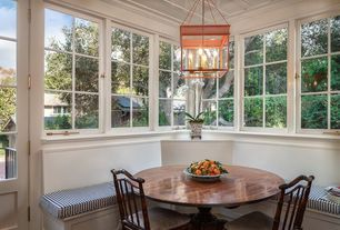 Traditional Dining Room with Window seat, Glass panel door, Box ceiling, Chandelier, Standard height, Casement, Crown molding