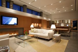 Contemporary Great Room with High ceiling, Concrete floors, flush light, Columns, interior wallpaper