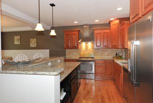 Country Kitchen with Inset cabinets, Pendant light, Wall Hood, Simple granite counters, Breakfast bar, Built In Refrigerator