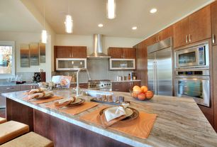 Contemporary Kitchen with Breakfast bar, Complex granite counters, Undermount sink, Pendant light, Glass panel, Flush
