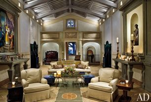 Mediterranean Living Room with Arched window, limestone floors, High ceiling, Exposed beam, Wainscotting