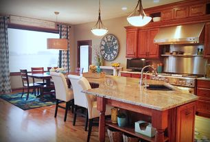 Traditional Kitchen with Standard height, Complex granite counters, full backsplash, French doors, Pendant light, can lights