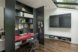 Modern Home Office with can lights, Skylight, flush light, Built-in bookshelf, Hardwood floors, Standard height