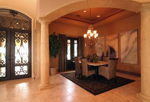 Mediterranean Dining Room with sandstone tile floors, French doors, stone tile floors, High ceiling, Columns, can lights