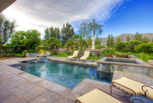 Traditional Swimming Pool with exterior stone floors, Pathway, Fence, Raised beds, Pool with hot tub, Fountain