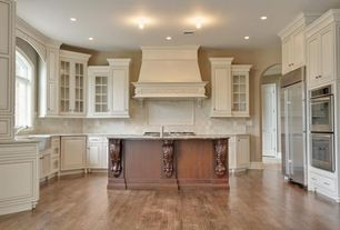 Traditional Kitchen with double wall oven, Kitchen island, Simple granite counters, U-shaped, Limestone Tile, Standard height