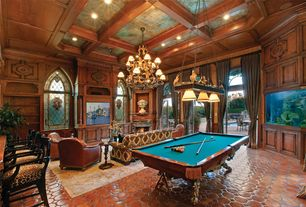 Traditional Game Room with High ceiling, Transom window, Built-in bookshelf, French doors, Cement fireplace, Arched window