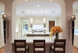 Contemporary Kitchen with can lights, full backsplash, Complex Marble, U-shaped, Kitchen island, Standard height, Custom hood