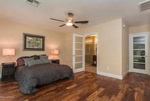 Contemporary Master Bedroom with French doors, Hardwood floors, Ceiling fan