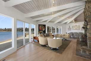 Contemporary Living Room with Hardwood floors, Waterfront, Exposed beam, flush light, sliding glass door, Open concept