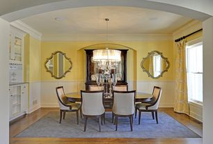 Traditional Dining Room with Crown molding, Standard height, double-hung window, Wainscotting, Chandelier, Hardwood floors