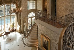 Traditional Staircase with Concrete floors, interior wallpaper, Cathedral ceiling, Balcony, curved staircase