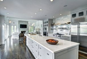 Transitional Kitchen with Dura Supreme Cabinetry Dalton Panel, Complex marble counters, Kitchen island, Breakfast nook