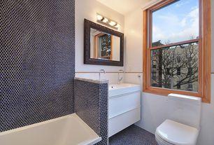 Eclectic Full Bathroom with penny tile floors, Toto NC Series Toilet, Lyric Retro Gloss Glazed Hexagon Tiles, Vessel sink