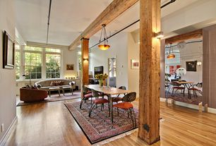 Contemporary Great Room with Built-in bookshelf, flush light, Exposed beam, Hardwood floors, Wall sconce