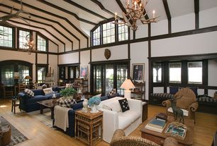 Country Great Room with Hardwood floors, Window seat, Exposed beam, Chandelier, High ceiling, Crown molding