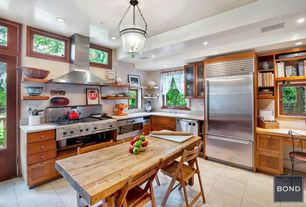 Eclectic Kitchen with Limestone counters, Glass panel, Wood counters, Kitchen island, Undermount sink, Transom window, Flush