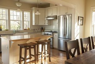 Craftsman Kitchen with Butcher block island, Aaron wood seat chair, French doors, Inset cabinets, Simple marble counters
