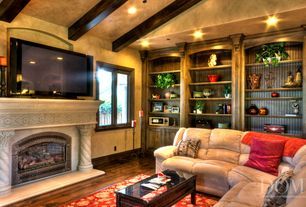 Mediterranean Living Room with Built-in bookshelf, Casement, Cement fireplace, Crown molding, Exposed beam, can lights