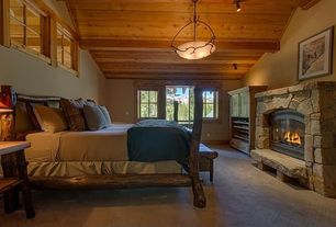 Rustic Guest Bedroom with Standard height, Silver Creek Bed Aspen, Fireplace, Carpet, Paint 1, stone fireplace, can lights