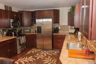 Contemporary Kitchen with Standard height, can lights, Freestanding Full Size Top Freezer Refrigerator, Multiple Sinks, Flush